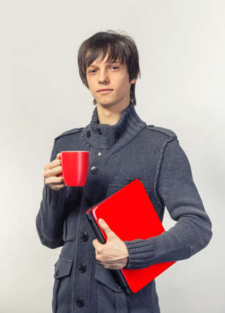 casual happy teenager with laptop and cup