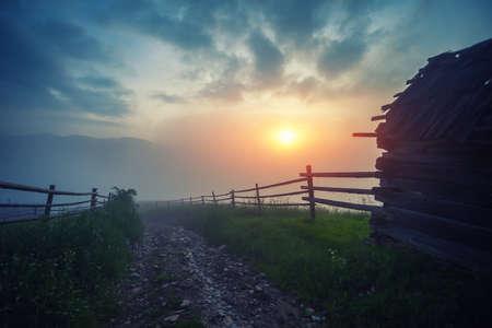 Summer landscape. Foggy mountain village in the Ukrainian Carpathians. Dramatic sky. Stock Photo