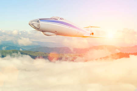 Big passenger airplane in the clouds. travel by air transport.