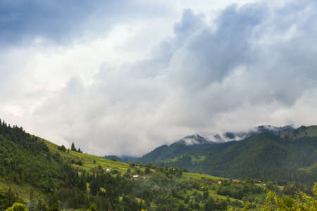 Majestic view on beautiful fog mountains in mist landscape. Dramatic unusual scene. Travel background. Exploring beauty world. Carpathian mountains. Ukraine. Europe. Stock Photo