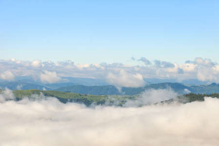 Beautiful and famous travel location The landscape photo, beautiful sea fog in morning time at Carpathians, Ukraine.