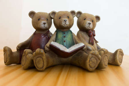 distractions: Bear read all three books. Stock Photo