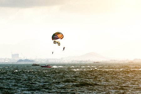 chandler: The speedboat towing a parachute to float to the player. Stock Photo