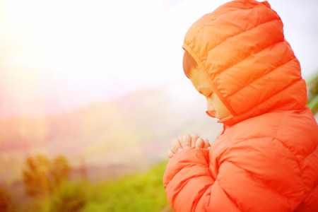 Children are praying on the mountain.
