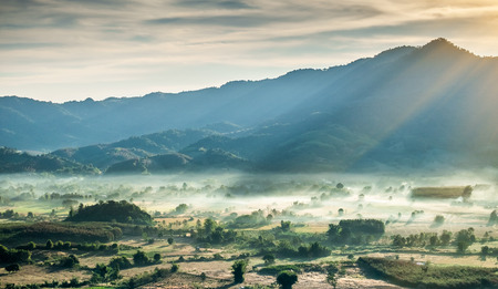 Misty mountains and sunlight in the morning