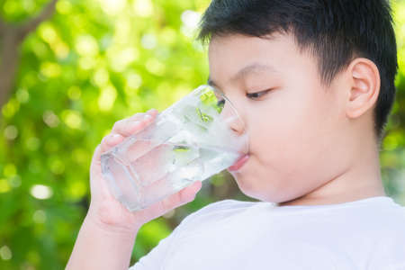 Boy drinking clean water from glass Archivio Fotografico