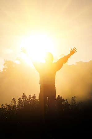 Children raise hands and sunlight