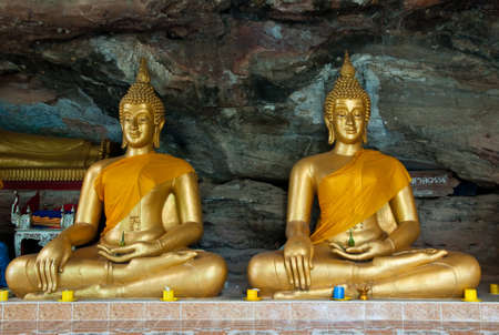 Buddha on stone babkground in cave of Thailand  photo
