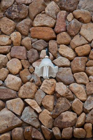 white lamp on stone wall  photo