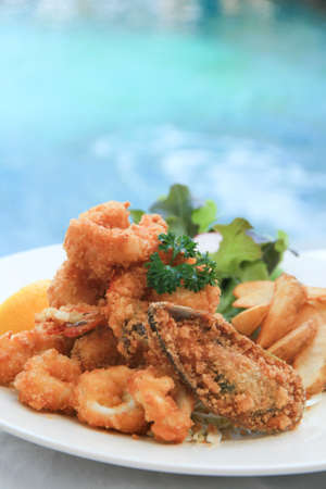Deep-fried flour coated seafood with tartar sauce and home-cut fries Stock Photo - 11549750
