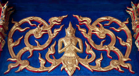 Gold Thai Paining in front of Temple photo