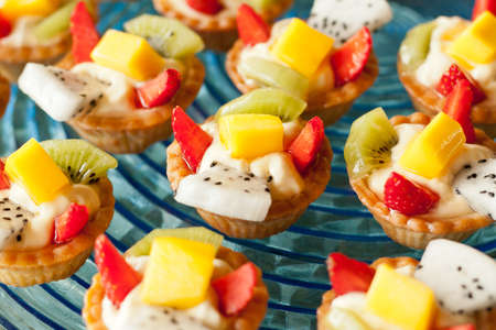 Fruit tarts of mixed Strawberry, Kiwi, Mango, Dragon fruit  Stock Photo - 12416522
