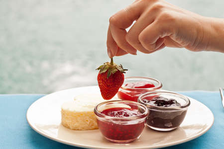 GELATIN: Heart shape cheesecake decorated with fresh strawberry on top and variety of topping sauce