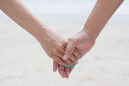 Hand holding hand Stock Photo - 12416634