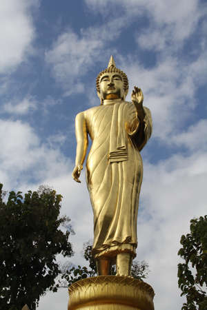 Golden buddha with blue sky
