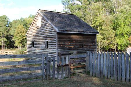 rafters: A log tobacco barn Stock Photo