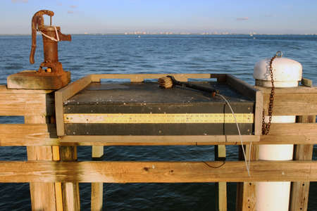 A public fish cleaning station on the pier in Sanibel Island, Florida, USA Stock Photo