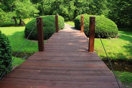 cary: Old wooden bridge in the park in summertime, Cary, North Carolina