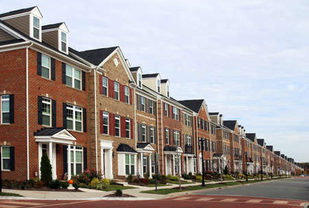 townhouses: A perspective row of modern townhouses in the summer Stock Photo