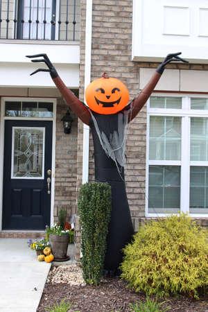blow up: Pumpkin-head blow up doll. Halloween front door decorations Stock Photo