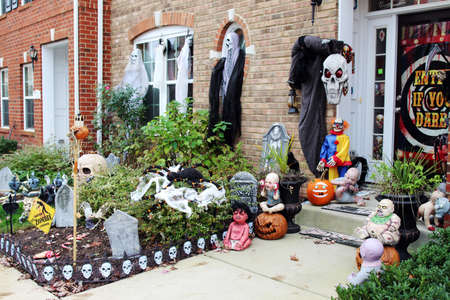 Spooky scene on the front porch. Halloween front door decorations