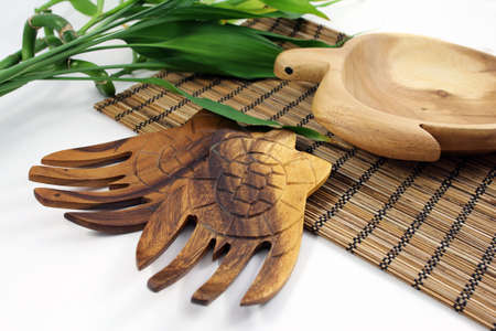 Oriental wooden salad serving hands with hand-carved wooden turtle bowl