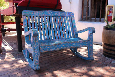 hand carved: A hand crafted Mexican bench. Old Wood Carved and Painted Rustic Bench. Old Town Market, San Diego, California USA