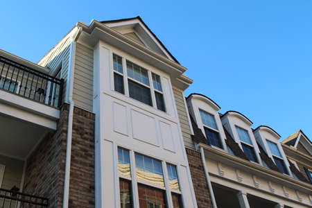 Modern townhouse facades in the sunny day, low camera angle view. Virginia, USA