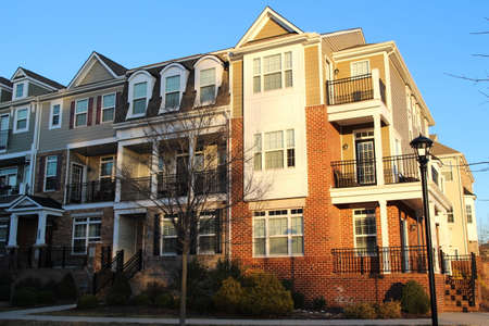 Modern townhouses with balconies in the sunny day, Virginia, USA