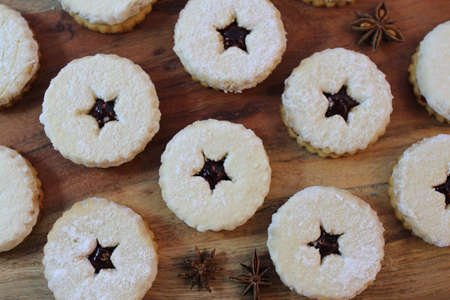 Close-up of traditional linzer cookies on the wooden background