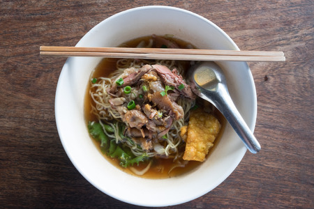 boned: Stewed pork noodle soup with morning glory and bean sprout. Stock Photo