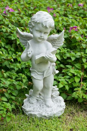 Cupid stucco in the garden Stock Photo