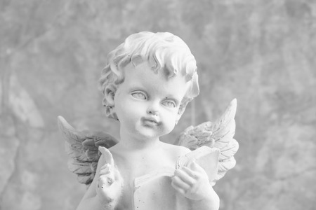 Cupids statue Stock Photo