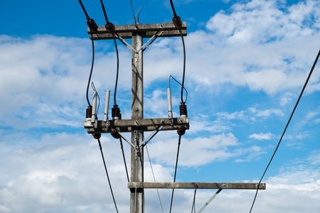 high tech: An electric pole with a blue sky background.
