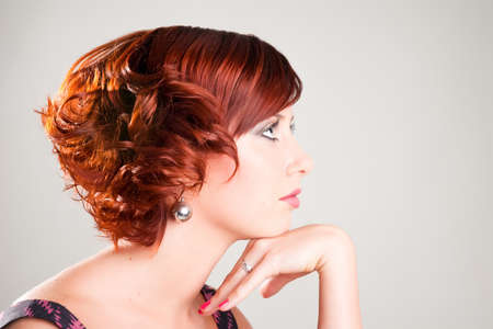 portrait of attractive red haired young woman Stock Photo