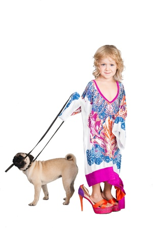 pretty girl in mama's dress hold the dog Stock Photo