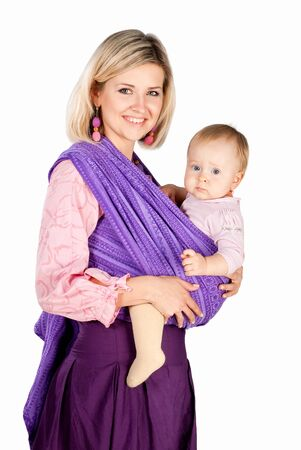 young mother with baby in sling in studio  isolated photo