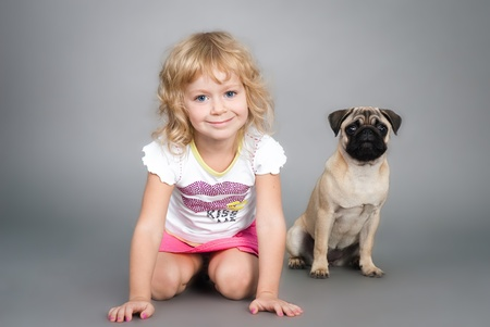 cute little girl playing with a dog Stock Photo
