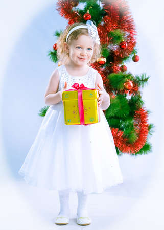 cute girl wearing snowflake costume with gift photo