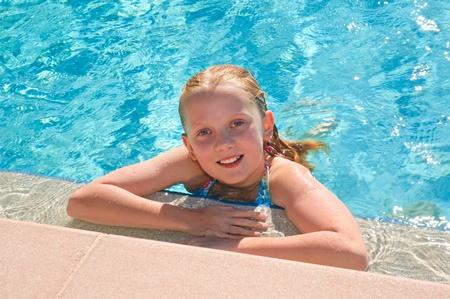 youg girl relaxing in pool photo