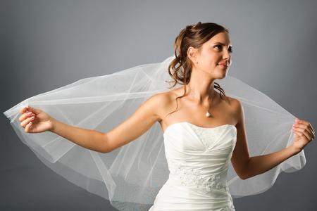 portrait of romantic bride wearing a veil in studio Stock Photo
