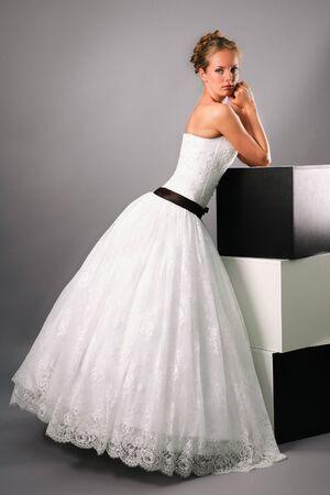 beautiful bride wearing black b white wedding dress in studio photo
