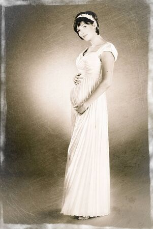 old fashioned sepia: artificial  sepia photo of beautiful young pregnant woman