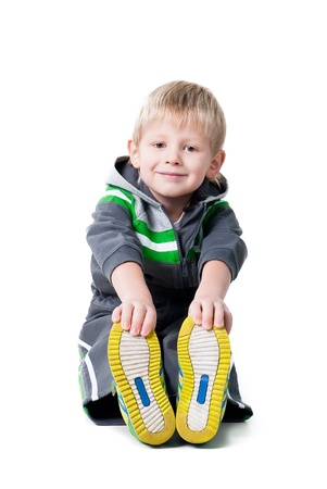 happy sportive boy making workout on white background Stock Photo