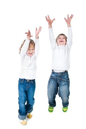 wear: two excited kids jumping up isolated on white background