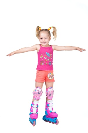 rollerskater: Cute roller skating little girl isolated on white background