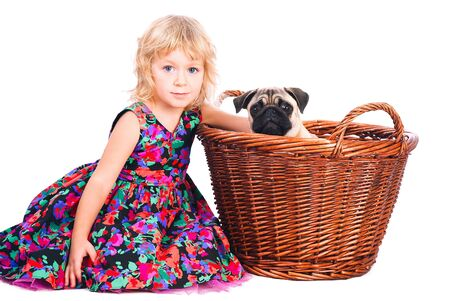 isolated portrait of little girl hugging dog on white background photo