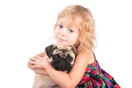 isolated portrait of pretty girl hugging pug dog