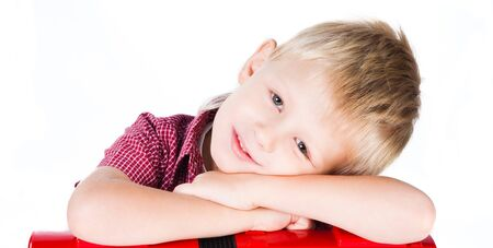 portrait of young smiling boy isolated on white photo