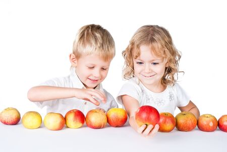 two siblings choosing with apples isolated on white